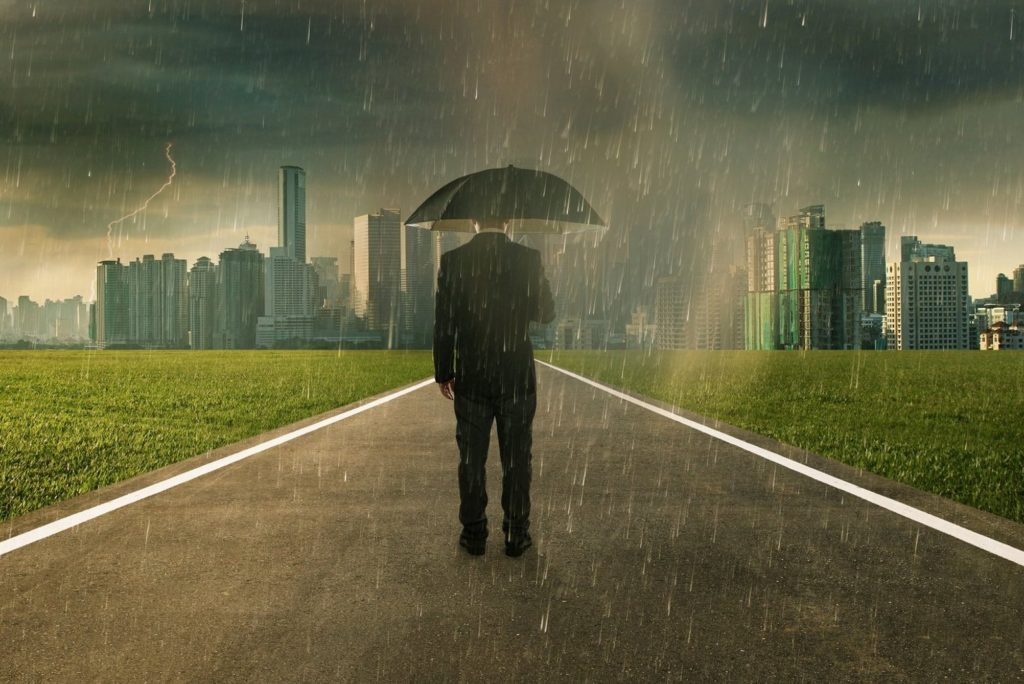 graphicstock-businessman-below-storm-rain-with-umbrella-risk-and-crisis-concept_r_Hgr1hPeoe (1)